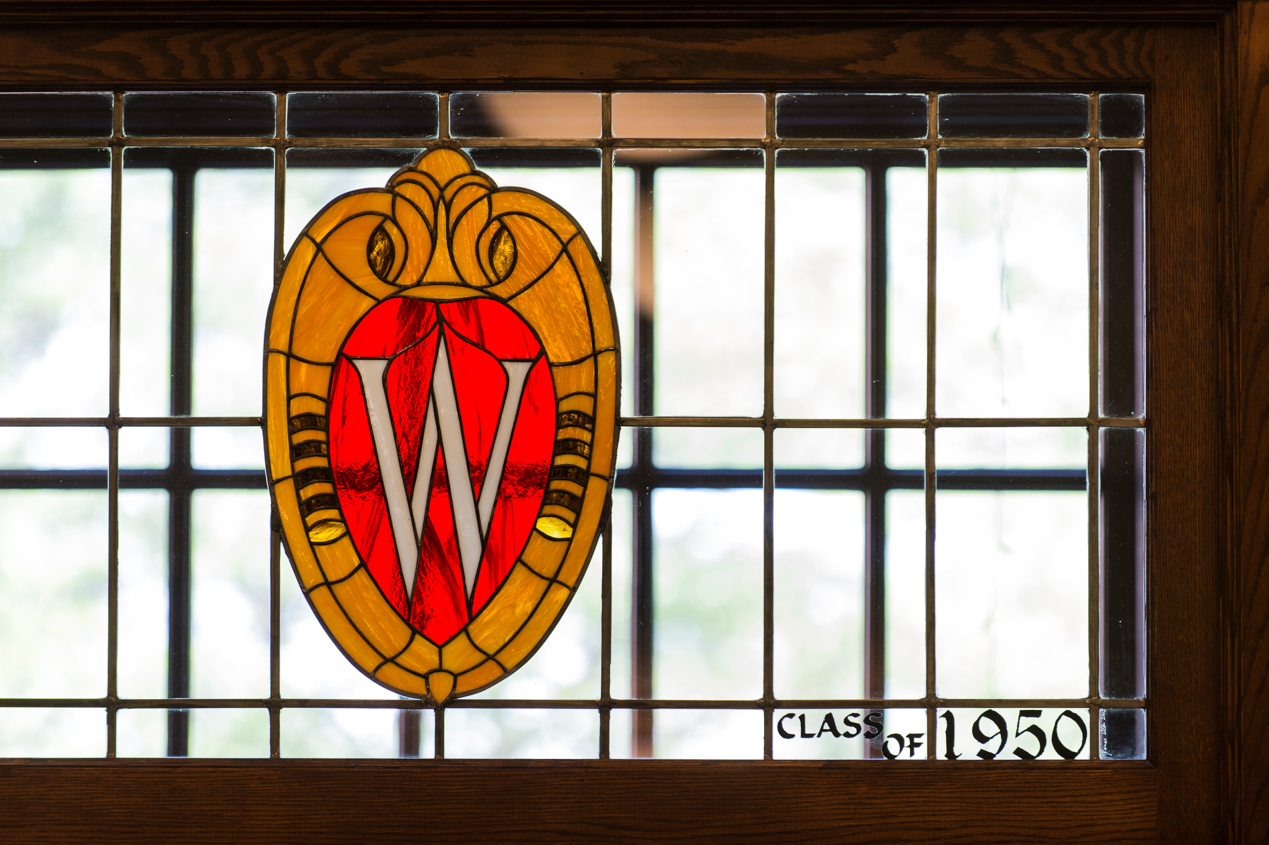Stained glass W crest at Memorial Union